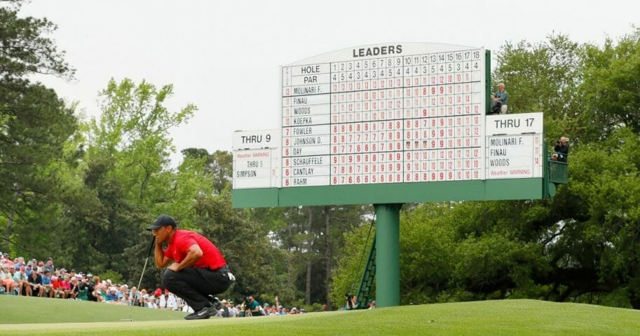 Tiger Woods of the United States lines up a putt on the 18th green during the final round of the Masters at Augusta National Golf Club on April 14, 2019, in Augusta, Georgia.