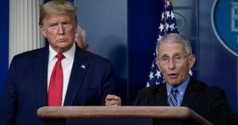 Dr. Anthony Fauci, director of the National Institute of Allergy and Infectious Diseases, speaks as President Donald Trump looks on during a briefing on the coronavirus pandemic at the White House on March 24, 2020.