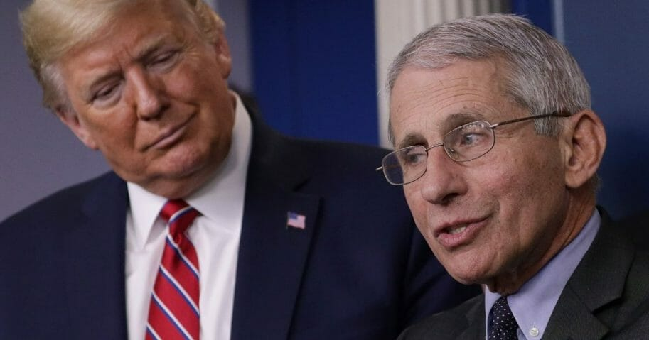 President Donald Trump listens to Dr. Anthony Fauci, director of the National Institute of Allergy and Infectious Diseases, during a corona task force briefing at the White House on March 20, 2020.