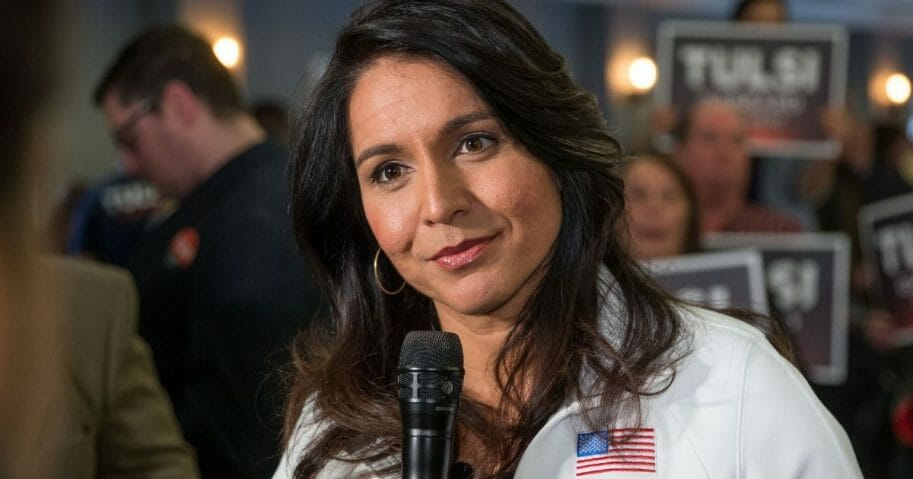 Democratic Rep. Tulsi Gabbard of Hawaii answers media questions following a campaign event in Portsmouth, New Hampshire, on Feb. 9, 2020.