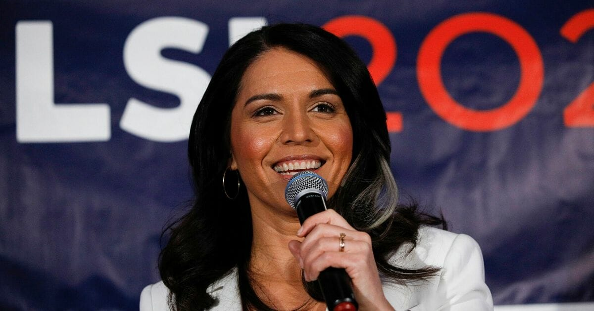 Democratic presidential candidate and Rep. Tulsi Gabbard of Hawaii talks to supporters during a Super Tuesday event March 3, 2020, in Detroit.