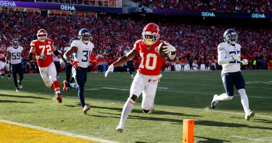 Tyreek Hill #10 of the Kansas City Chiefs runs the ball into the end zone for a touchdown during the AFC championship game against the Tennessee Titans at Arrowhead Stadium on Jan. 19, 2020, in Kansas City, Missouri.