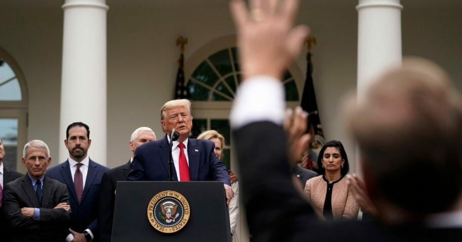 President Donald Trump takes questions at a news conference about the ongoing global coronavirus pandemic in the Rose Garden at the White House on March 13, 2020, in Washington, D.C.