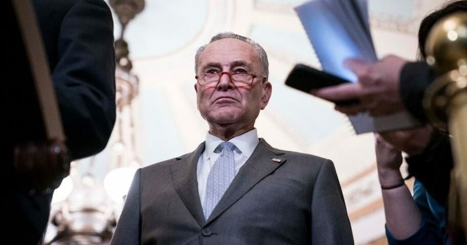 Senate Minority Leader Sen. Chuck Schumer listens during a news conference following the weekly Democratic caucus luncheon where U.S. Vice President Mike Pence, Secretary of Health and Human Services Alex Azar and members of the coronavirus task force briefed senators on March 3, 2020, in Washington, D.C.