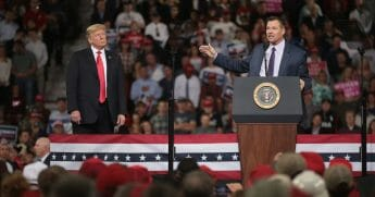 Then-candidate for governor of Kansas Kris Kobach speaks at a rally with President Donald Trump at the Kansas Expocenter on Oct. 6, 2018, in Topeka, Kansas.