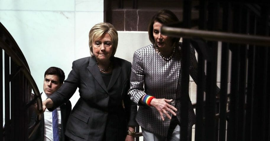 Accompanied by then-House Minority Leader Nancy Pelosi, right, then-Democratic presidential candidate Hillary Clinton leaves after meeting with House Democrats on June 22, 2016, in Washington, D.C.