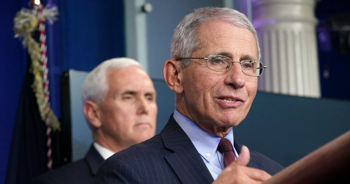 Dr. Anthony Fauci, director of the National Institute of Allergy and Infectious Diseases, speaks as Vice President Mike Pence listens during the daily White House coronavirus briefing on March 31, 2020.