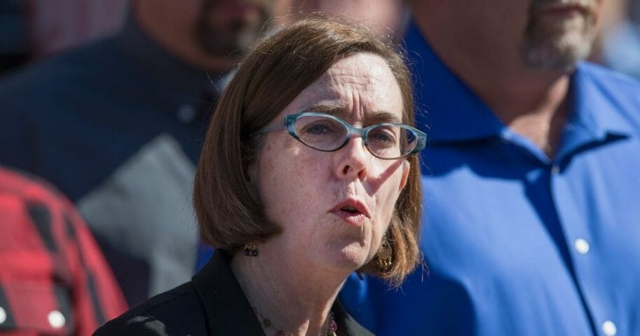 Oregon Gov. Kate Brown speaks to the media about the mass shooting at Umpqua Community College on Oct. 2, 2015, in Roseburg, Oregon.