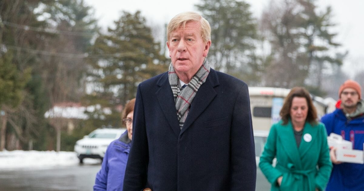 Former Massachusetts Gov. William Weld, a former Republican presidential candidate, arrives to greet voters at the Webster Elementary School during the presidential primary on Feb. 11, 2020, in Manchester, New Hampshire.