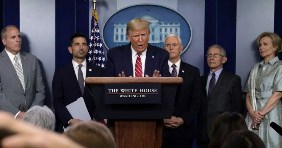 Flanked by members of the coronavirus task force, President Donald Trump speaks during a news briefing on the latest development of the coronavirus outbreak in the U.S. at the James Brady Press Briefing Room at the White House on March 20, 2020, in Washington, D.C.