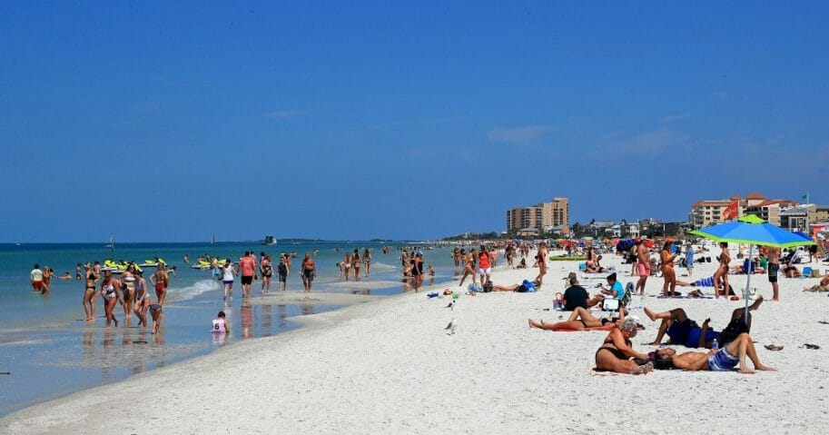 People gather on Clearwater Beach during spring break despite world health officials' warnings to avoid large groups on March 18, 2020, in Clearwater, Florida.