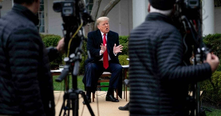 President Donald Trump participates in a Fox News virtual town hall with anchor Bill Hemmer in the Rose Garden of the White House on March 24, 2020.