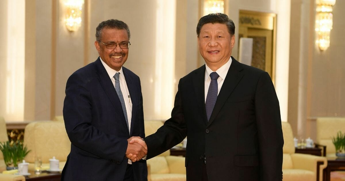 World Health Organization Director-General Tedros Adhanom Ghebreyesus, left, shakes hands with Chinese President Xi Jinping before a meeting at the Great Hall of the People in Beijing on Jan. 28, 2020.
