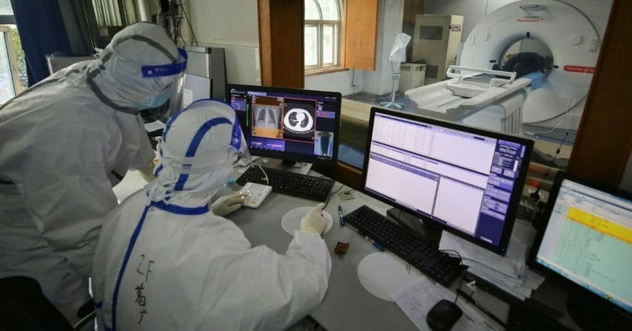 Medical staff conduct a CT scan for a patient infected by the COVID-19 coronavirus at Red Cross Hospital in Wuhan in China's central Hubei province on March 11, 2020.