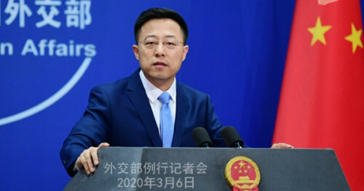 Zhao Lijian speaks at a news conference on March 6, 2020.