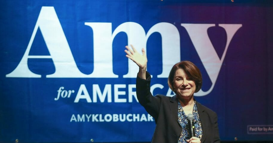 Former Democratic presidential candidate Sen. Amy Klobuchar of Minnesota waves to her supporters after speaking during her presidential campaign rally at The Depot in Salt Lake City on March 2, 2020.