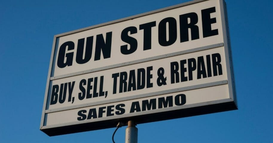 A stock photo of a gun store is seen in the photo above.