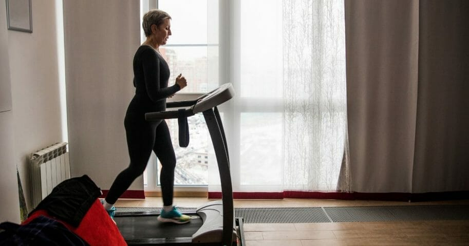 A woman exercises on a treadmill in the stock image above.