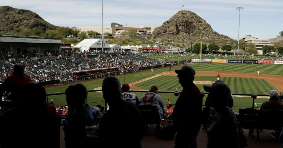 Fans watch a spring training baseball game between the Los Angeles Angels and San Diego Padres on Feb. 27, 2020, in Tempe, Arizona.