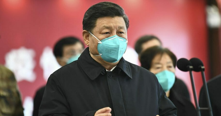 In this March 10, 2020, file photo released by China's Xinhua News Agency, Chinese President Xi Jinping talks by video with patients and medical workers at the Huoshenshan Hospital in Wuhan in central China's Hubei Province.