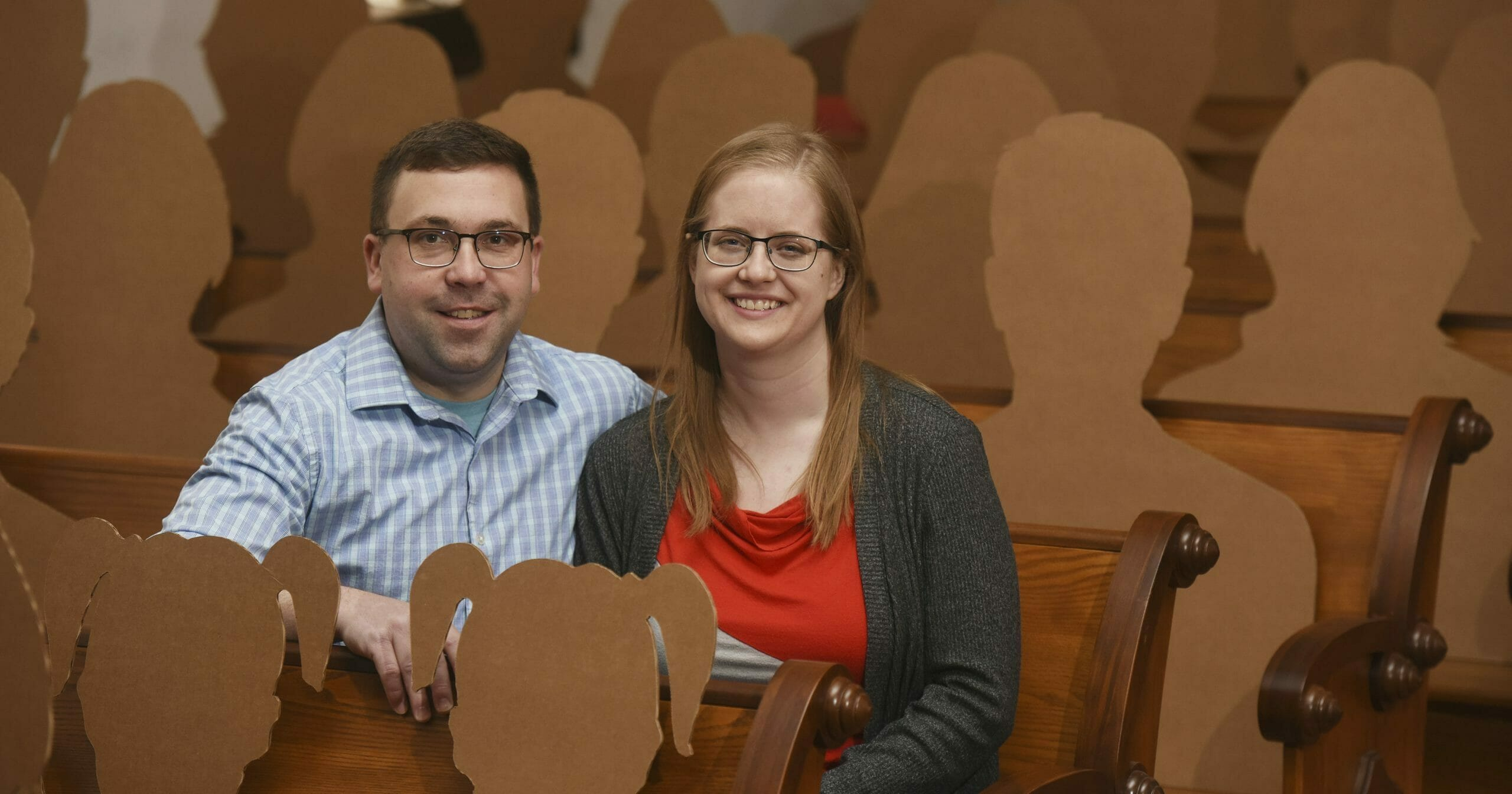 Dan Stuglik and Amy Simonson are photographed with cardboard cutouts of family and friends March 31, 2020, in Pokagon, Michigan.