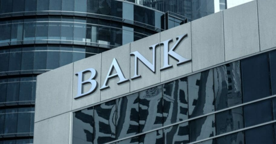 A stock photo of a bank is seen above.