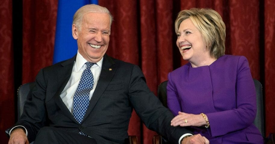 Former Vice President Joe Biden and former Secretary of State Hillary Clinton laugh during a portrait unveiling for outgoing Senate Minority Leader Senator Harry Reid on Capitol Hill in Washington on Dec. 8, 2016.