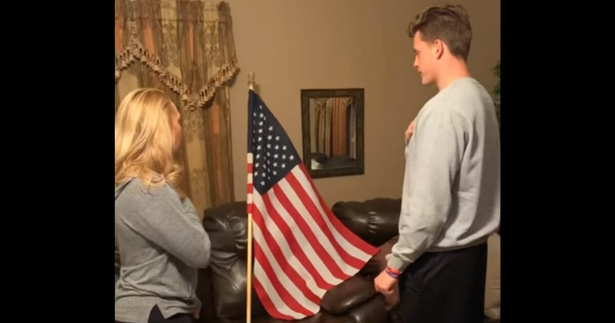 Former LSU quarterback Joe Burrow, the top pick in the 2020 NFL draft, recites the Pledge of Allegiance alongside his mother, Robin, the principal of a school in Meigs County, Ohio.