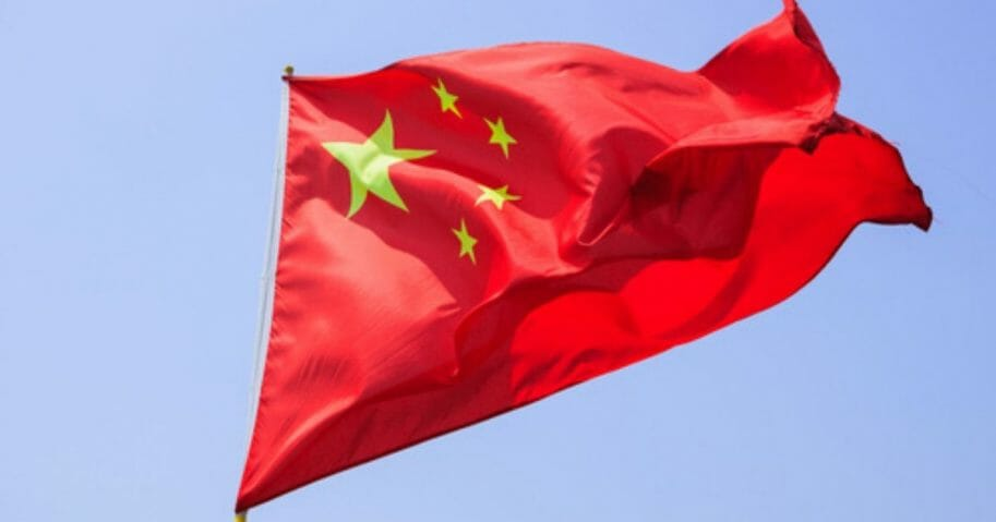 A stock photo of the Chinese flag is seen above.