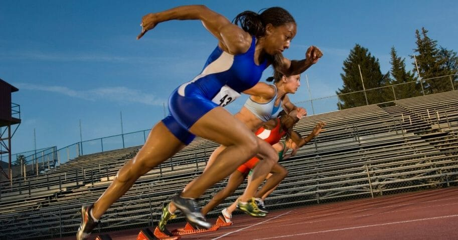 Female athletes are seen racing against each other in the stock photo above.
