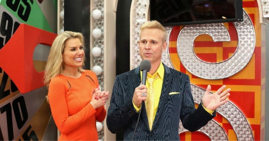 """George Gray appears with """"The Price is Right"""" model Rachel Reynolds in 2014."""
