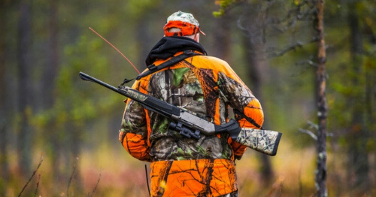 A stock photo of a hunter is seen above.