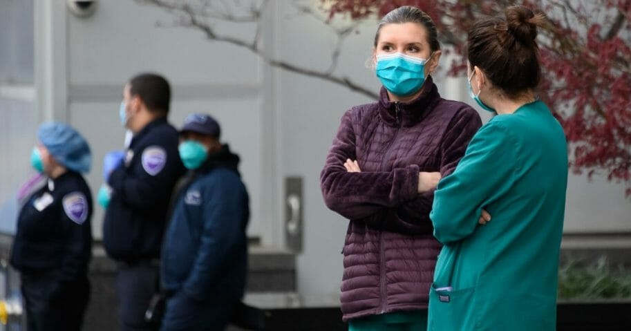 Medical personnel wear protective masks outside NYU Langone Health hospital in New York City on April 4, 2020.