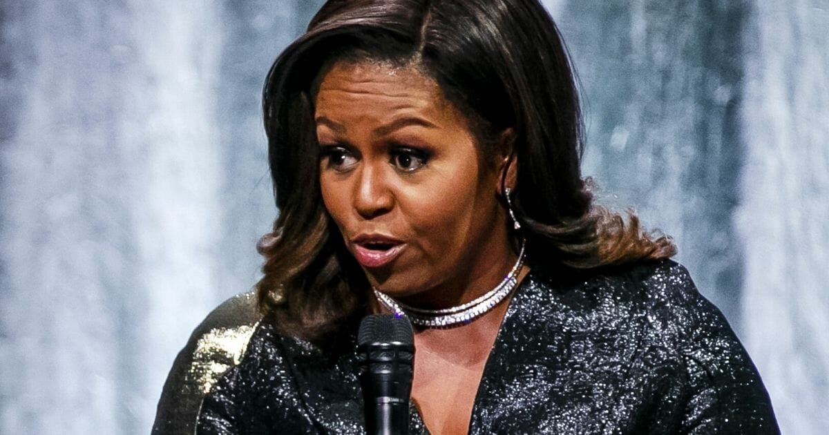 """Former first lady Michelle Obama talks about her autobiography """"Becoming"""" on stage at the Ziggo Dome in Amsterdam on April 17, 2019."""