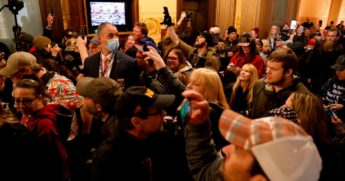 Protesters try to enter the Michigan House of Representatives chamber in Lansing on April 30, 2020.
