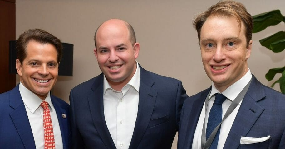 Vanity Fair correspondent and NBC News contributor Gabriel Sherman, right, poses with financier Anthony Scaramucci, left, and Brian Stelter, CNN's chief media correspondent, at Vanity Fair's New Establishment Summit at the Wallis Annenberg Center for the Performing Arts in Beverly Hills, California, on Oct. 22, 2019.