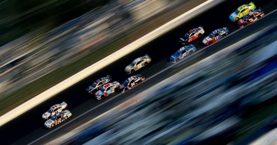 Cars race in the Monster Energy NASCAR Cup Series Coca-Cola 600 at Charlotte Motor Speedway in North Carolina on May 26, 2019.