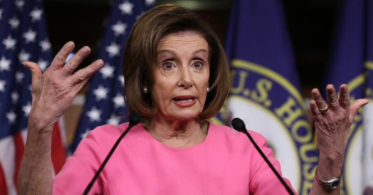 House Speaker Nancy Pelosi of California speaks during a news conference March 26, 2020, in Washington.