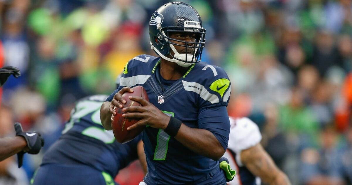 Quarterback Tarvaris Jackson of the Seattle Seahawks looks downfield to pass against the Denver Broncos in a preseason game at CenturyLink Field in Seattle on Aug. 14, 2015.