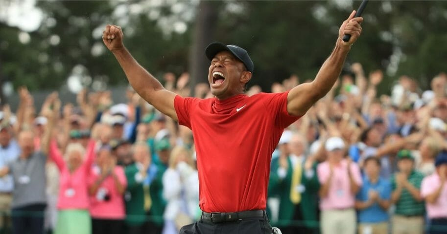 Tiger Woods celebrates on the 18th green after winning the Masters at Augusta National Golf Club in Georgia on April 14, 2019.