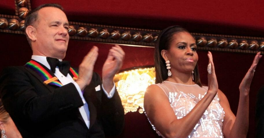 Actor/producer Tom Hanks, left, and then-first lady Michelle Obama attend the 27th Annual Kennedy Center Honors at John F. Kennedy Center for the Performing Arts on Dec. 7, 2014, in Washington, D.C.