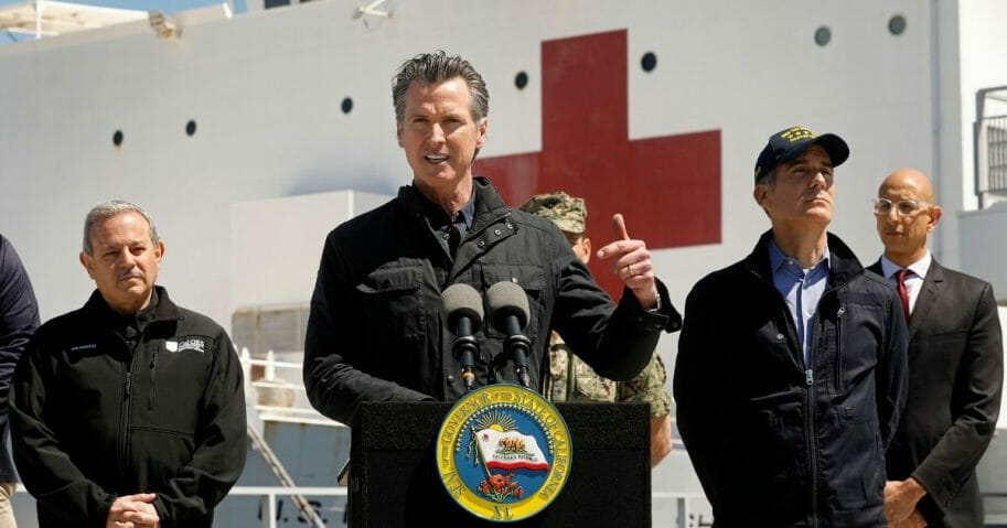 California Gov. Gavin Newsom speaks in front of the hospital ship USNS Mercy that arrived at the Port of Los Angeles on March 27, 2020, to provide relief for Southland hospitals overwhelmed by the coronavirus pandemic.