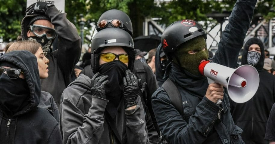 Antifa protestors hide their faces at a protest on August 17, 2019, in Portland, Oregon