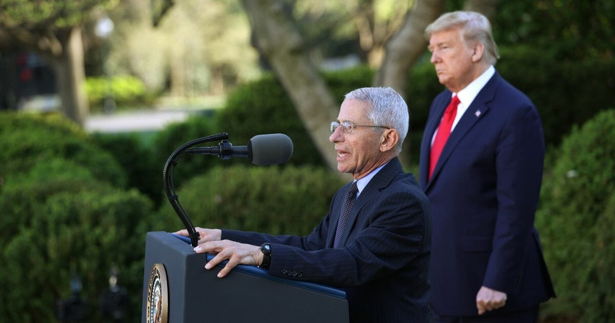 Dr. Anthony Fauci, the director of the National Institute of Allergy and Infectious Diseases, speaks as President Donald Trump listens during the daily coronavirus briefing at the Rose Garden of the White House on March 30, 2020.