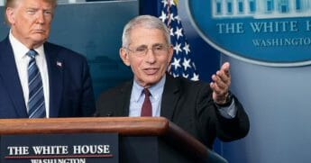 Dr. Anthony Fauci, director of the National Institute of Allergy and Infectious Diseases, speaks alongside President Donald Trump at a White House news briefing Sunday.