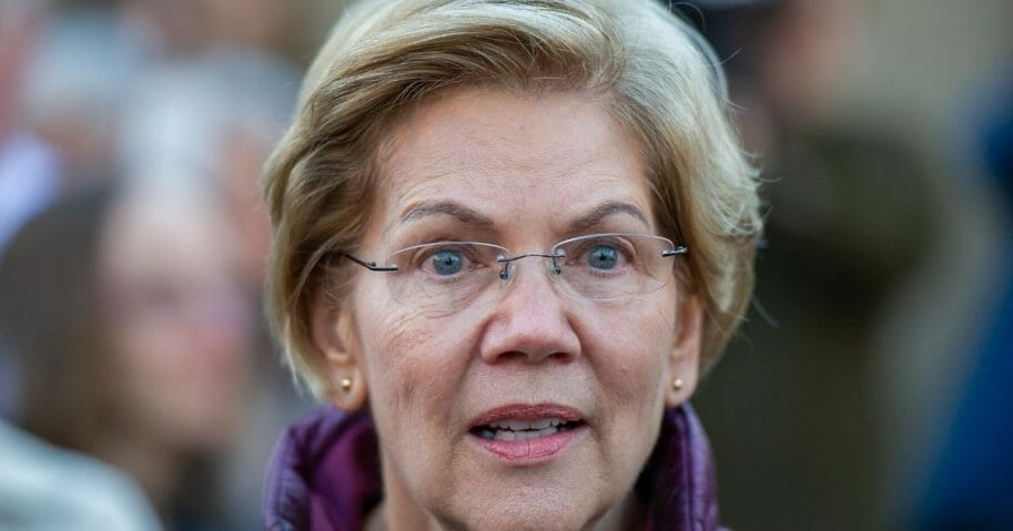 Democratic Sen. Elizabeth Warren of Massachusetts announces the suspension of her presidential campaign in front of her Cambridge, Massachusetts, home on March 5, 2020.