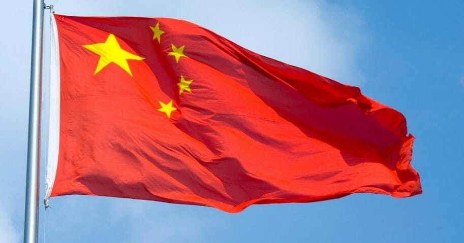 The Chinese flag flaps in the wind on Aug. 5, 2010, in Shanghai.