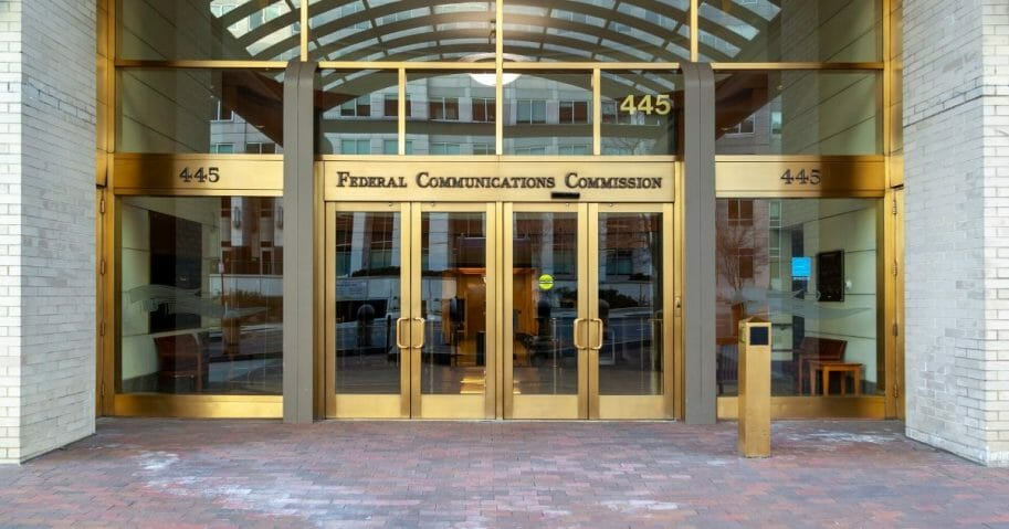 Stock image of the entrance to the building housing the Federal Communications Commission in Washington, D.C.