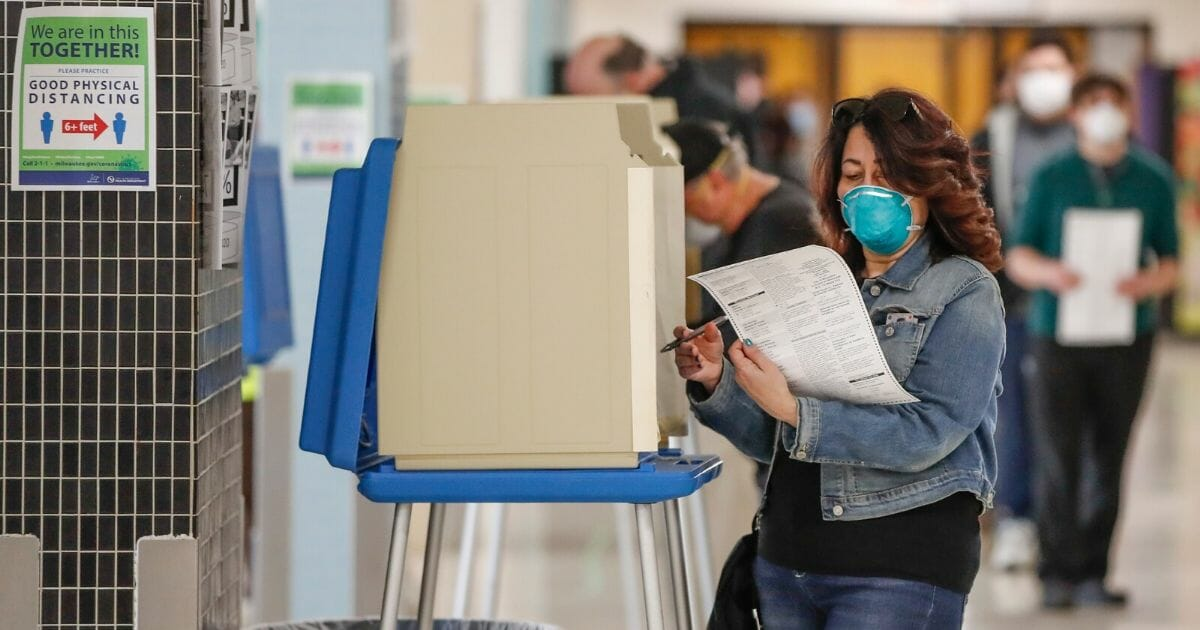 A woman casts her ballot in a Democratic presidential primary election at the Hamilton High School in Milwaukee, Wisconsin, on Tuesday.