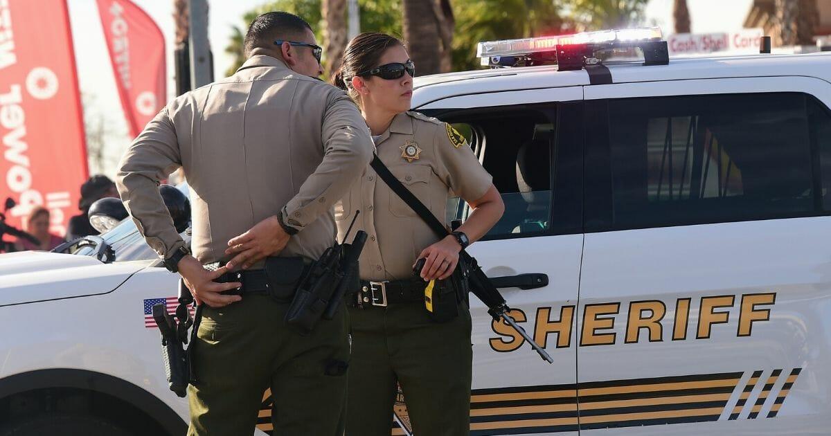 Armed officers from the San Bernardino County Sheriff's Department on patrol near the scene of the crime in San Bernardino, California, on Dec. 2, 2015.